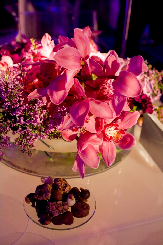 Floral tablescapes were created for the sixteen adult dinner tables using a ...