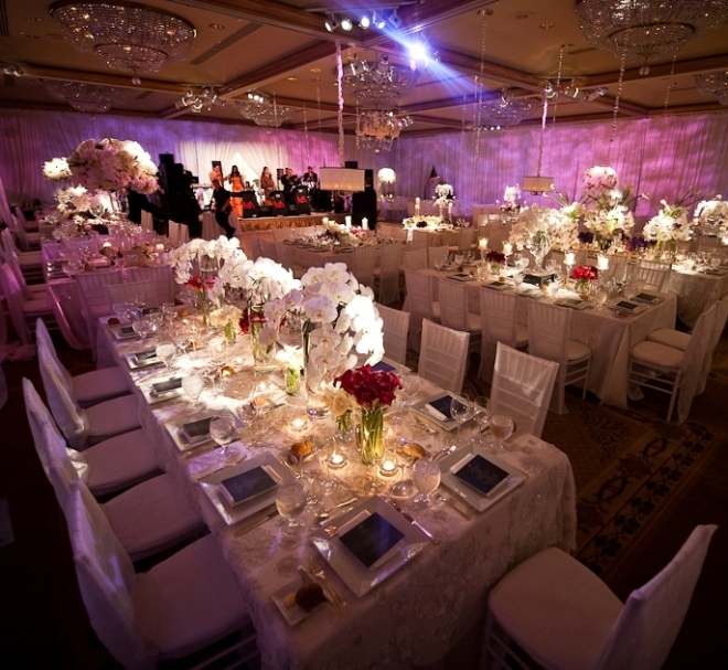 purple lighting in ballroom, suspended lampshades over tables