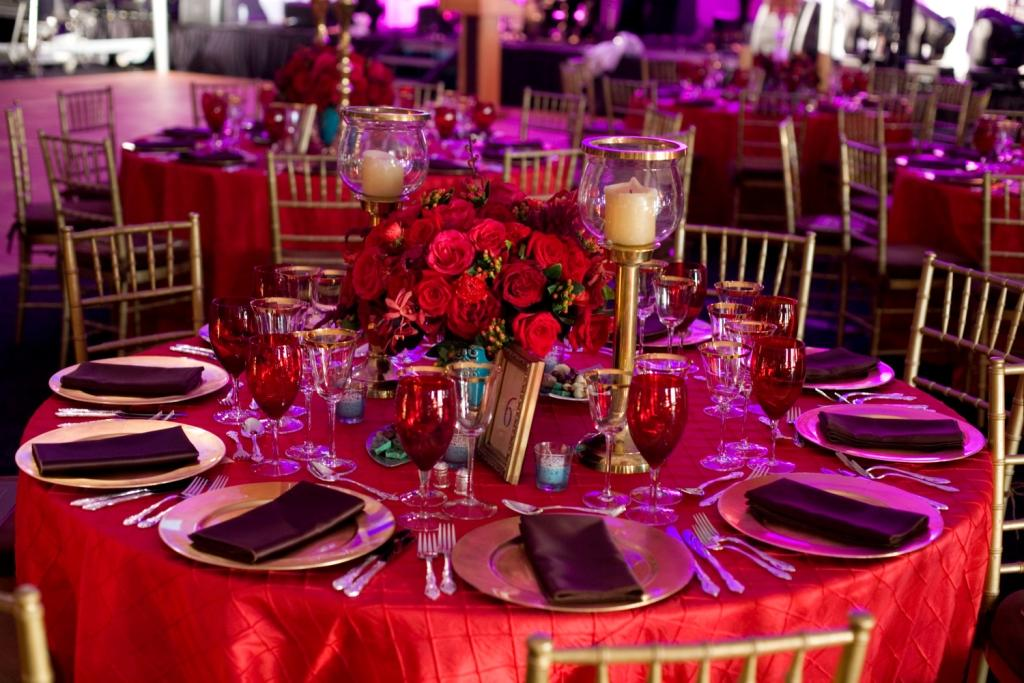 Red floral party centerpieces red linens gold chivaris tented events