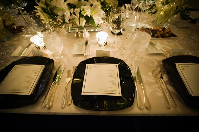 black chargers white upholstered tables ballroom weddings philadelphia