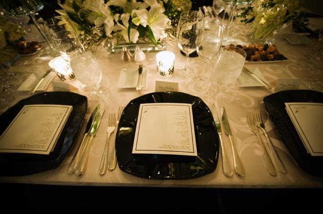 black chargers white upholstered tables ballroom weddings philadelphia