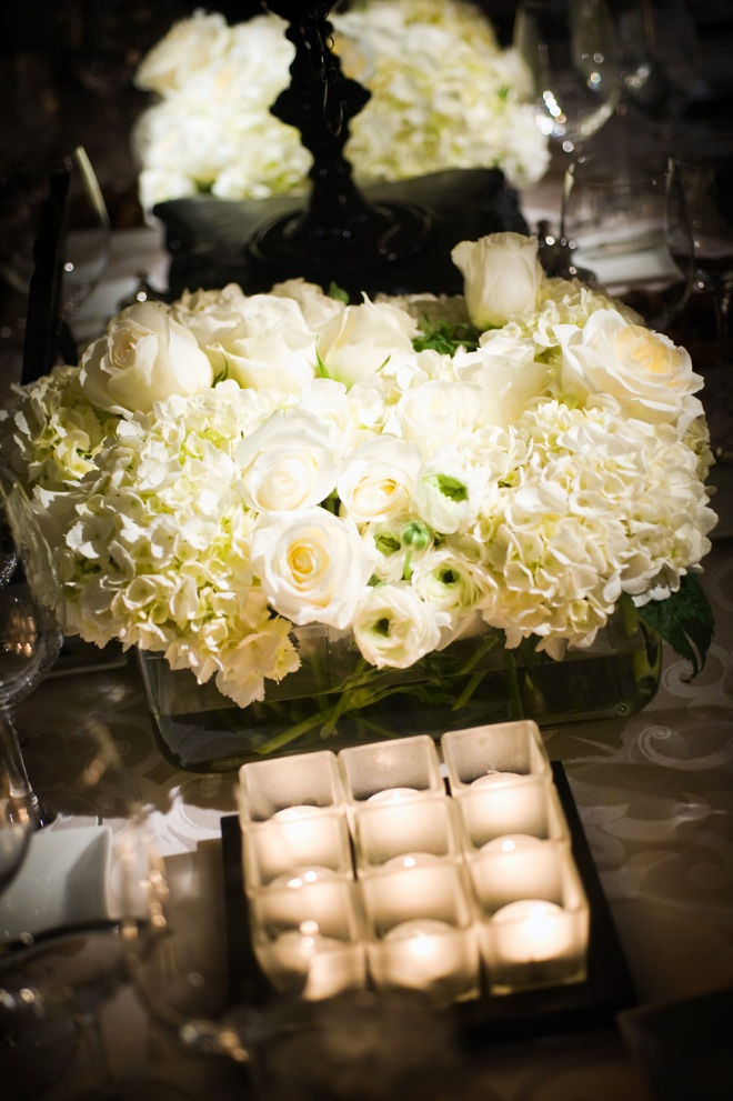white hydrangea roses ranunculus wedding centerpieces