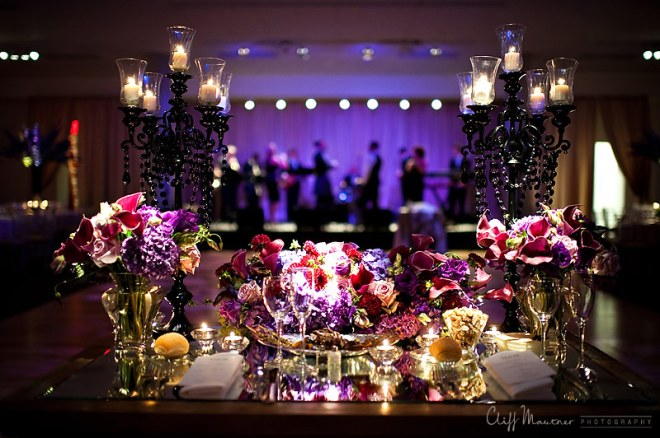 sweetheart tables for weddings purple flowers black chandeliers