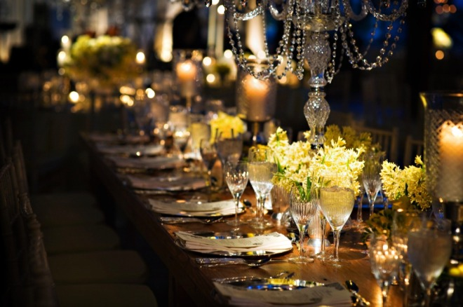 Long wooden dinner tables crystal chandeliers yellow flowers philadelphia weddings