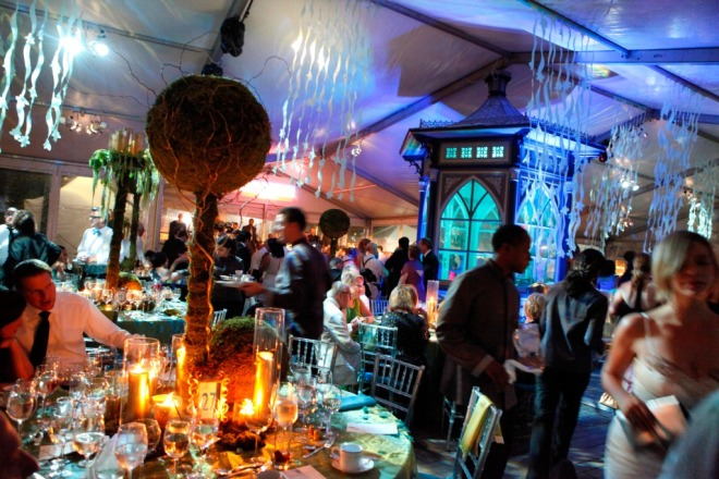 Dinner Tent with Gold Furniture Aqua Blue linens Moss Green Centerpeices Blue Lighting Eventions Productions