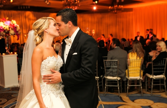 bride and groom kiss end of ceremony aisle four seasons hotel luxury weddings