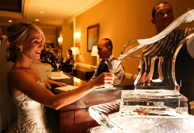 bride enjoying the ice luge martini bar four seasons hotel philadelphia luxury weddings