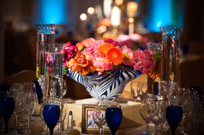 orange and pink floral centerpiece philadelphia weddings evantine design