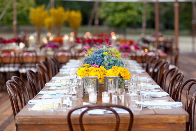 Blue Hydrangea yellow zinnias wooden feast tables sailcloth tented weddings