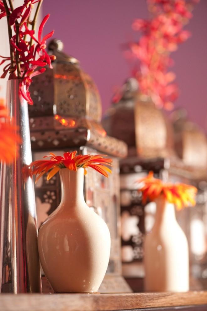 chrome accessories for event design white vases orange gerbera daisies
