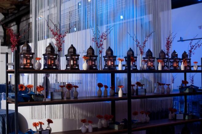 food station design moroccan lanterns orange gerber daisies philadelphia event planners