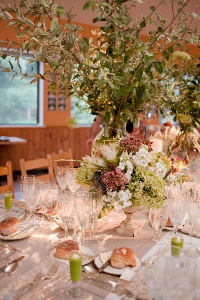 Tall Wedding Centerpieces with Branches Ivory Linens Weathered Iron Urns Crystal Stemware