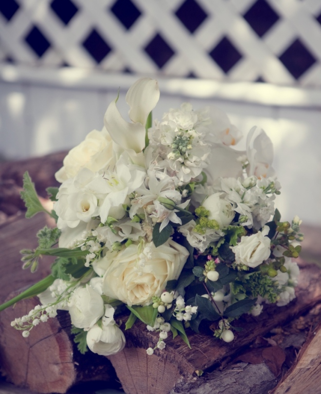 white country bridal bouquets snow berries ranunculus lily of the valley evantine design