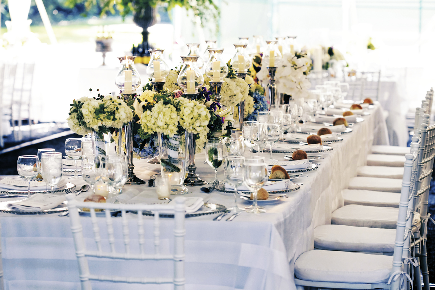 Real stories a classic white and blue tented wedding in for Blue and white weddings
