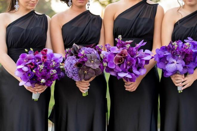 purple bridal bouquets orchids black bridesmaids dresses