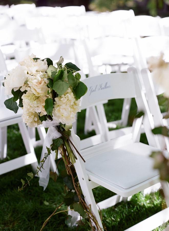 white garden chairs for wedding ceremonies with white garden pew arrangements evantine design