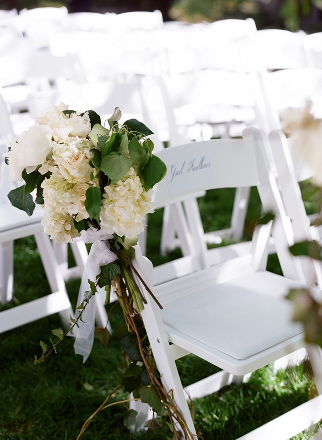 white garden chairs for wedding ceremonies with white garden pew arrangements evantine design