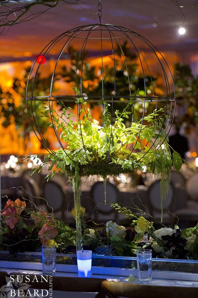 Floral Spheres on the rectangular dinner tables. Evantine Design.
