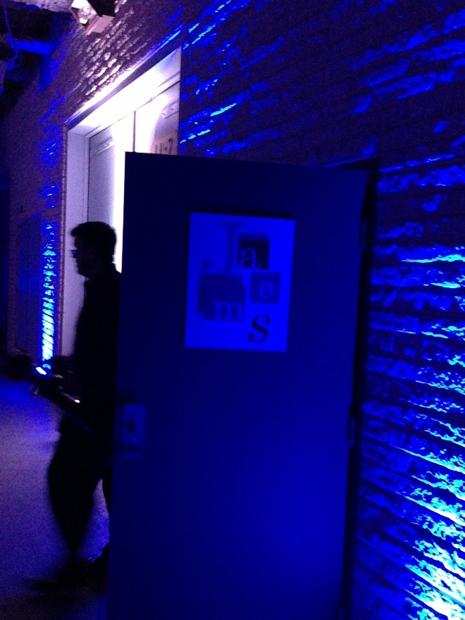 Secret Entrance to the Party lit up in dramatic blue lighting.
