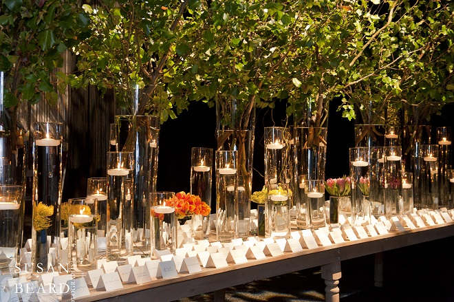 Floating candles and sparkling glass vases. Evantine Design.
