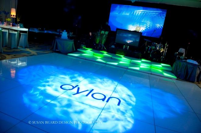 dance floor monograms white dance floor with blue lighting effects evantine designe eventions productions