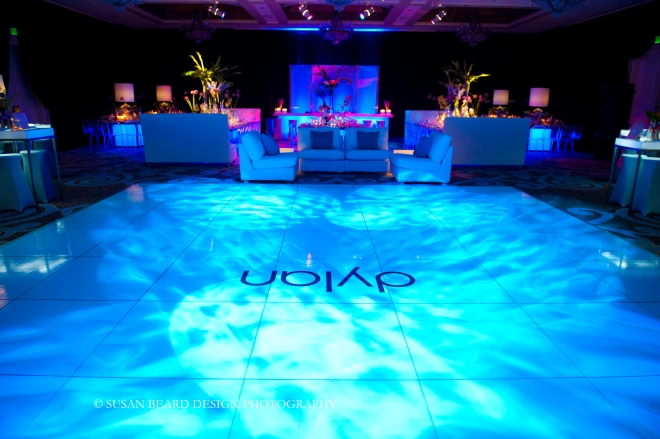 white dance floor with 1960s lighting effects blue lighting for parties evantine design