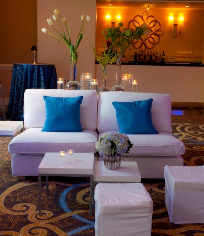 white lounge furniture with blue pillows for cocktail party four seasons hotel philadelphia evantine design